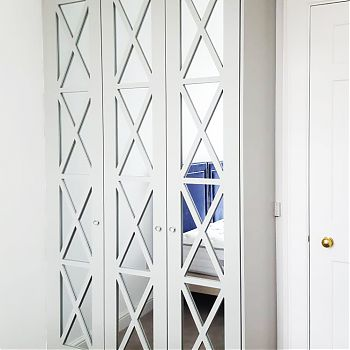 Stunning mirrored wardrobes withcornicing