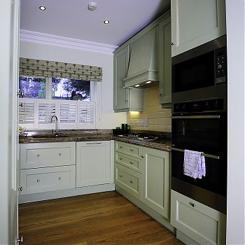 Compact gallery kitchen gold granite